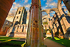Side chapel & bell tower of Fountains Abbey , founded in 1132, is one of the largest and best preserved ruined Cistercian monasteries in England. The ruined monastery is a focal point of England's most important 18th century Water, the Studley Royal Water Garden which is a UNESCO World Heritage Site. Near Ripon, North Yorkshire, England