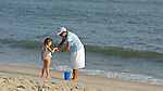 Active Aging Senior Citizens, Retired, Activities, Child and Elderly Woman, Beach,