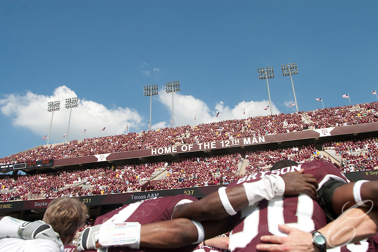 "The Texas A&M football team joins the Kyle Field student section, known as ""The 12th Man,"" in singing the schools' War Hymn after a victory over Baylor in 2007."