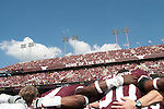 """The Texas A&M football team joins the Kyle Field student section, known as """"The 12th Man,"""" in singing the schools' War Hymn after a victory over Baylor in 2007."""