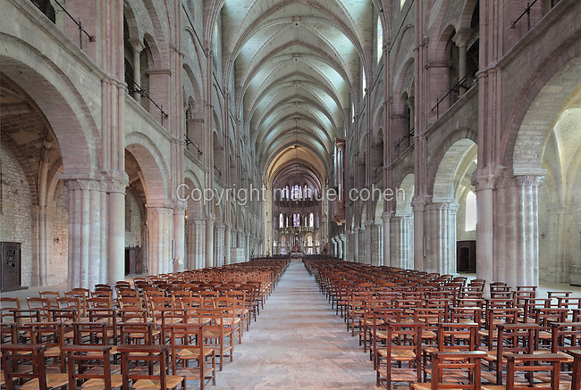 Nave with its 11 rib vaulted bays, looking towards the choir, in the Basilique Saint Remi or Abbey of St Remi, Reims, France. The 11th century, mainly Romanesque, church, contains the relics of St Remi, the Bishop of Reims, who converted Clovis, the King of the Franks, to Christianity in 496 AD. The abbey is a UNESCO World Heritage Site. Picture by Manuel Cohen