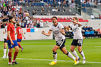 United States (USA) forward Abby Wambach (20) celebrates scoring her second goal of the match tying Mia Hamm's  record during an international friendly between the women's national teams of the United States and the Korea Republic at Red Bull Arena in Harrison, NJ, on June 20, 2013.