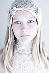 Close up of young girl wearing lace headdress