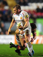 Carl Rimmer of Exeter Chiefs looks to offload the ball after being tackled. Aviva Premiership match, between Leicester Tigers and Exeter Chiefs on March 3, 2017 at Welford Road in Leicester, England. Photo by: Patrick Khachfe / JMP