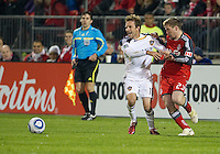 13 April 2011: Los Angeles Galaxy forward Mike Magee #18 and Toronto FC midfielder Jacob Peterson #23 in action during an MLS game between Los Angeles Galaxy and the Toronto FC at BMO Field in Toronto, Ontario Canada..The game ended in a 0-0 draw.