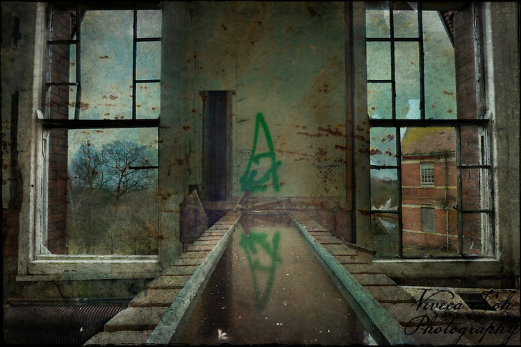 Channel of water inside Hellingly Asylum http://www.vivecakohphotography.co.uk/2011/02/07/stygian-echoes/