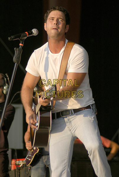 CHUCK WICKS. Jamboree In The Hills 2008, the Superbowl of Country Music, is a four day Country Music Festival established in 1977 with over 100,000 people in attendance this year, Morristown, Ohio, USA, 17 July 2008..half length live on stage gig jeans white t-shirt microphone guitar .CAP/ADM/KB.© Kelly Blecher/Admedia/Capital Pictures