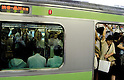 Tokyo, Japan - A packed train at stops at Shinjuku Station. Morning commuters typically spend over one hour on the train going to work. Trains are usually so packed that train platform staff have to push commuters to fit in the train so that the doors can close shut. (Photo by Yumeto Yamazaki/AFLO)