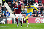 Hearts v St Johnstone....06.05.12   SPL.Cillian Sheridan shoots wide of the goal as Andy Webster closes in.Picture by Graeme Hart..Copyright Perthshire Picture Agency.Tel: 01738 623350  Mobile: 07990 594431