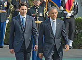 United States President Barack Obama, right and Prime Minister Justin Trudeau of Canada, left, review the troops during an Arrival Ceremony on the South Lawn of the White House in Washington, DC on Thursday, March 10, 2016. <br /> Credit: Ron Sachs / CNP