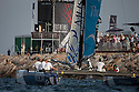 Extreme Sailing Series 2011. Leg 1. Muscat. Oman.Day 5 of racing.   Picture showing The Wave, Muscat skippered by Torvar Mirsky with teammates Kyle Langford, Nick Hutton and Khamis Al Anbouri.