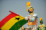 A particpant waves the Ghana flag during the Winneba Masquerade Festival in Winneba, Ghana on New Year's Day 2010.