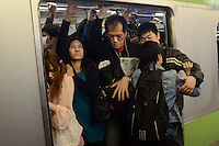 Passengers squeeze onto already full trains during morning rush hour, Shinjuku Station, Tokyo. With up to 4 million passengers passing through it every day, Shinjuku station, Tokyo, Japan, is the busiest train station in the world. The station was used by an average of 3.64 million people per day.  That&rsquo;s 1.3 billion a year.  Or a fifth of humanity. Shinjuku has 36 platforms, and connects 12 different subway and railway lines.  Morning rush hour is pandemonium with all trains 200% full. <br /> <br /> Photo by Richard jones / sinopix