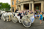 With family and friends gathered on the steps of Sleepy Hollow Country Club, the newly weds ride away in a horse drawn carriage.