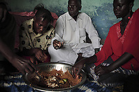 Family meal is only situation in Gandiol-Tassinere.  Family eating meal from left to right is Mohamed, Fatou Sarr, Ibriham Gueye (head of family) and Khady Wade (woman in RED)..Guy in white skull cap with goat in background is Fall Htikh +221 522 7417..Woman in beach settlement with red and yellow cloth on her head is: Marerme Dieng..Industrialized fishermen pay a license to fish, but then there is no limit for how much they can catch.  The artesenal fishermen are not regulated in any way.  The govt is realizing they have to have some control and banned fishing in November and are opening 5 MPA's...600,000 Senegalese participate in the fishing industry.  When you multiply that number times the 6 or 7 kids they each have and other dependents, you can see that this is a significant percentage of the 12 million Senegalese.  Eighty percent of the fish caught are caught by artesinal fishermen.