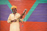 Man playing musical Instrument in the streets of Pushkar
