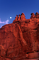 714000037 moonrise over the courthouse sandstone rock formation along the main drive in arches national park utah