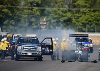 Sept. 29, 2012; Madison, IL, USA: NHRA Safety Safari members help top fuel dragster driver Pat Dakin after a small fire during qualifying for the Midwest Nationals at Gateway Motorsports Park. Mandatory Credit: Mark J. Rebilas-