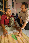 RARE Country Manager Hari Kushardanto and PeNA founder Jes discuss data for a community mapping project at Leupeng village.