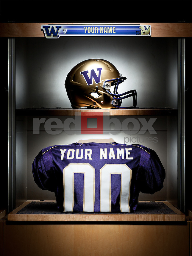 After you place your order, please follow up with an email to info@redboxpictures stating the name you would like added to the jersey. Please limit names to 12 characters. <br /> Jersey and helmet in the University of Washington football locker room. Photo by Andy Rogers / Red Box Pictures
