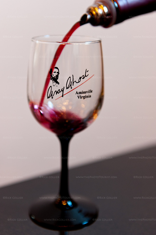 A taste of red is poured into my glass at Gray Ghost Vineyards.