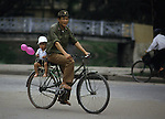 A father takes his child on a ride in Hanoi, North Vietnam.  (Jim Bryant Photo).....