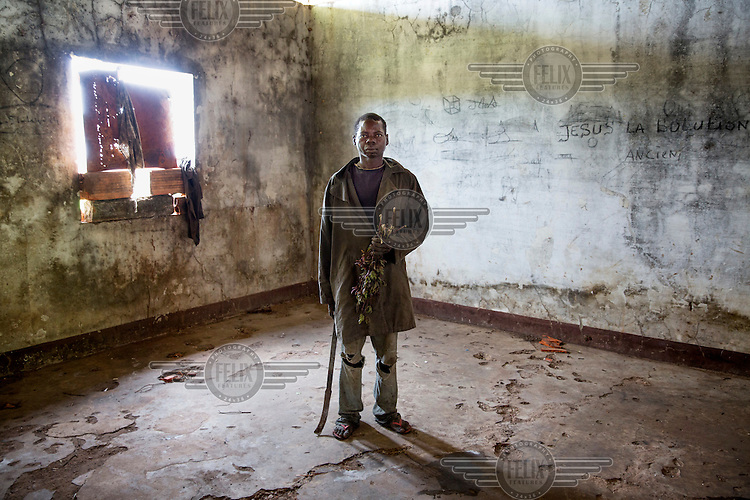 A man stands in an empty room in a building that once belonged to Emperor Bokassa. In 2013 a rebellion by a predominantly Muslim rebel group Seleka, led by Michel Djotodia, toppled the government of President Francios Bozize. Djotodia declared that Seleka would be disbanded but as law and order collapsed the ex-Seleka fighters roamed the country committing atrocities against the civilian population. In response a vigillante group, calling themselves Anti-Balaka (Anti-Machete), sought to defend their lives and property but they then began to take reprisals against the Muslim population and the conflict became increasingly sectarian. French and Chadian peacekeeping forces have struggled to contain the situation and the smaller Muslim population began to flee the country.