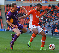 Blackpool's Colin Daniel holds off the challenge from Cheltenham Town's Carl Winchester<br /> <br /> Photographer Alex Dodd/CameraSport<br /> <br /> The EFL Sky Bet League Two - Blackpool v Cheltenham Town - Saturday 22nd April 2017 - Bloomfield Road - Blackpool<br /> <br /> World Copyright &copy; 2017 CameraSport. All rights reserved. 43 Linden Ave. Countesthorpe. Leicester. England. LE8 5PG - Tel: +44 (0) 116 277 4147 - admin@camerasport.com - www.camerasport.com