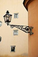 Street light on side of building, Gamla Stan - Old town, Stockholm, Sweden