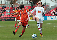 COLLEGE PARK, MD - OCTOBER 28, 2012:  Shannon Collins (73) of the University of Maryland closes in on Kate Howarth (1) of Miami during an ACC  women's tournament 1st. round match at Ludwig Field in College Park, MD. on October 28. Maryland won 2-1 on a golden goal in extra time.