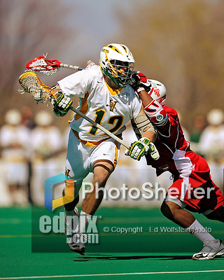 30 April 2011: University of Vermont Catamount midfielder Kyle Sminkey, a Senior from White River Junction, VT, in action against the Stony Brook Seawolves at Moulton Winder Field in Burlington, Vermont. The Catamounts fell to the visiting Seawolves 12-9 to conclude their America East season. Mandatory Credit: Ed Wolfstein Photo