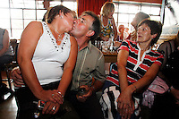 A couple kiss during the Lisdoonvarna matchmaking festival. Lisdoonvarna County Clare, Ireland. The matchmaking festival is a long held tradition in the small town of Lisdoonvarna, County Clare, Ireland. After the harvests in September, young farmers from all over Ireland come to Lisdoonvarna to find themselves a potential wife, with the help of the 'basadoiri' or matchmakers..Picture James Horan..ALL MY IMAGES ARE COPYRIGHT.NORMAL FEES WILL APPLY