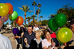 Balloons are passed out at the memorial service for Sun City resident Monte Haag, who moved to Sun City in 2000 and died in December 2010. He died in a crash flying an ultralight plane outside of Sun City. The service was held in Social Hall No. 1 of the Bell Recreation Center and the balloons were released from a tennis court Monte played on often in Sun City, Arizona December 11, 2010...2010 marks the 50th anniversary of Sun City, America's first retirement city that remains the largest today with more than 40,000 residents 55 and older.