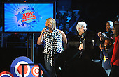 "Washington, DC - January 19, 2009 -- Queen Latifah is about to introduce family members of the United States Army National Guard 261st Signal Brigade to their loved ones deployed in Iraq via satellite at the ""Kids Inaugural: We Are the Future' concert at the Verizon Center in downtown Washington, D.C., Monday, January 19, 2009.  Michelle Obama, wife of President-elect Barack Obama, along with daughters Malia and Sasha, were in attendance. .Credit: Mark O'Donald - DoD via CNP."