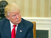 United States President-elect Donald Trump looks on as US Barack Obama makes remarks to the media pool in the Oval Office of the White House in Washington, DC on November 10, 2016.<br /> Credit: Ron Sachs / CNP<br /> (RESTRICTION: NO New York or New Jersey Newspapers or newspapers within a 75 mile radius of New York City)