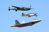 United States Air Force Heritage Flight featuring the F-22 Raptor, P-51D Mustang, and the P-38 Lightning displays the difference between the premier fighter of World War II and the Air Force's most current fighter during the 2008 Reno National Championship Air Races held annually in September at Stead Field in Nevada.