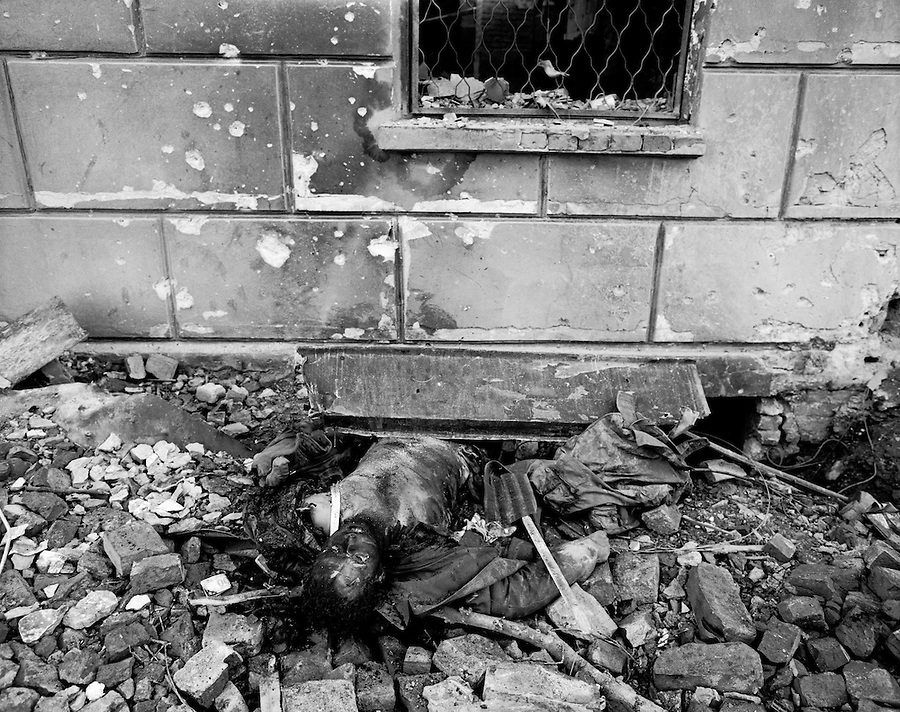 Grozny, Chechnya, March 1995..The burnt corpse of a fighter lies in a city centre street after rebel forces retreated from the city in the face of the Russian bombardment..