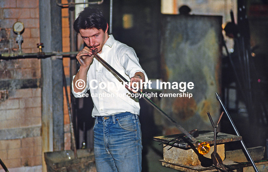 An operative blowing glass at the Tyrone Crystal factory, Dungannon, Co Tyrone, N Ireland, UK. 19850001TC4.<br />