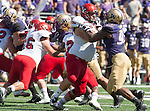 Washington Huskies'  defensive lineman Greg Gaines (99) is blocked by Eastern Washington Eagles' offensive lineman Jake Rodgers (65) at Husky Stadium September 6, 2014 in Seattle. Huskies out lasted the Eagles in a high powered shootout 59-52 in the third highest scoring game in Husky history. ©2014. Jim Bryant  Photo. All Rights Reserved