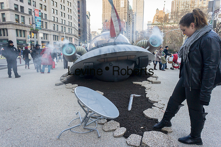 A promotion for Adult Swim television programming features a crash-landed spaceship in Madison Square in  New York on Sunday, December 1, 2013.  (© Richard B. Levine)