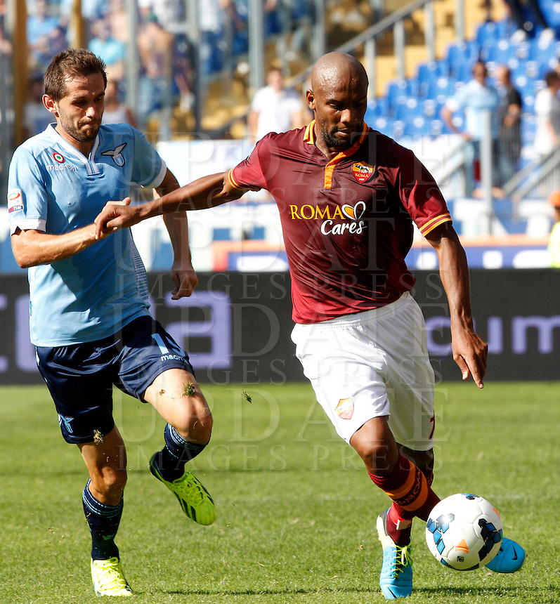 Calcio, Serie A: Roma vs Lazio. Roma, stadio Olimpico, 22 settembre 2013.<br /> AS Roma defender Maicon, of Brazil, right, is challenged by Lazio midfielder Senad Lulic, of Bosnia, during the Italian Serie A football match between AS Roma and Lazio, at Rome's Olympic stadium, 22 September 2013.<br /> UPDATE IMAGES PRESS/Riccardo De Luca