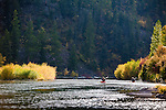 A late season paddle down the Blackfoot River with fall color lining the shores greets kayakers above Missoula, Montana