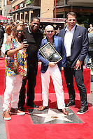 HOLLYWOOD, CA - JULY 15: Pitbull, pictured with  Lil Jon, Luther Campbell and Tony Robbins, receives star at the Hollywood Walk of Fame in Hollywood, California on July 15, 2016. Credit: David Edwards/MediaPunch