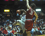 "Ole Miss guard Dundrecous Nelson (5)  shoots as Arkansas' Michael Sanchez (31) defends at C.M. ""Tad"" Smith in Oxford, Miss. on Saturday, March 5, 2010. Ole Miss won 84-74."