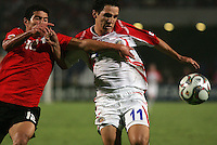 Costa Rica's Diego Madrigal (11) fights for control of the ball against Egypt's Islam Ramadan (12) during the FIFA Under 20 World Cup Round of 16 match between Egypt and Costa Rica at the Cairo International Stadium on October 06, 2009 in Cairo, Egypt.