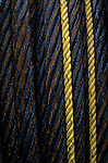 Close up of rusting oily steel cable with yellow ropes Industrial area in downtown Ballard Seattle Washington State USA