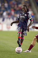 New England Revolution midfielder Shalrie Joseph (21) passes the ball. Real Salt Lake defeated the New England Revolution, 2-1, at Gillette Stadium on October 2, 2010.