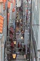 Steep, narrow street in the Old Town of Dubrovnik, Croatia. The city developed as an important port in the 15th and 16th centuries and has had a multicultural history, allied to the Romans, Ostrogoths, Byzantines, Ancona, Hungary and the Ottomans. In 1979 the city was listed as a UNESCO World Heritage Site. Picture by Manuel Cohen