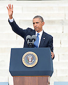 United States President Barack Obama waves to the crowd after making remarks at the Let Freedom Ring ceremony on the steps of the Lincoln Memorial to commemorate the 50th Anniversary of the March on Washington for Jobs and Freedom.<br /> Credit: Ron Sachs / CNP