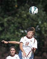 Boston College midfielder Jana Jeffrey (12) heads the ball. Virginia Tech (maroon) defeated Boston College (white), 1-0, at Newton Soccer Field, on September 22, 2013.